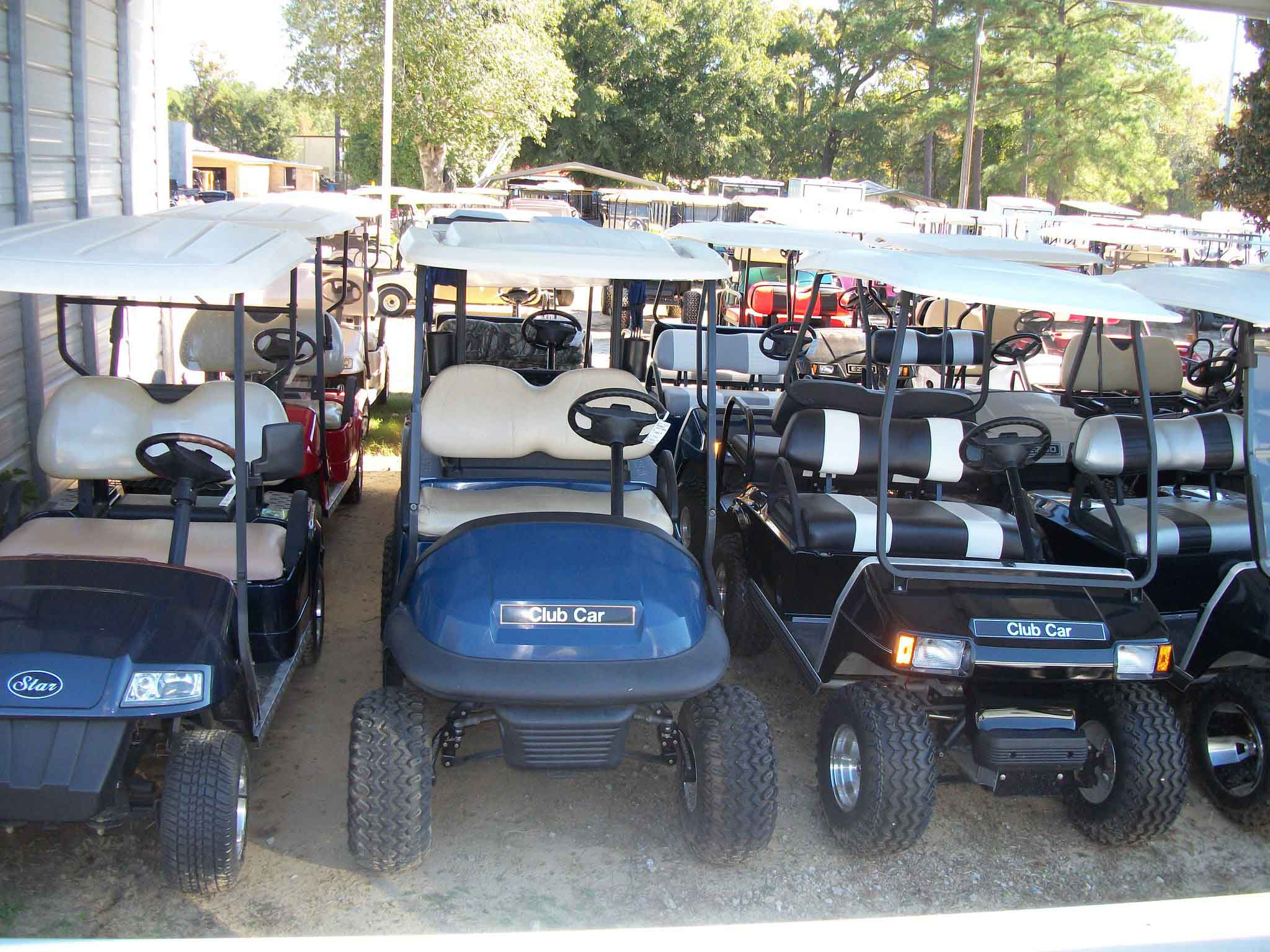 Lot with many Golf cars
